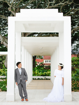 bride and groom in white frame